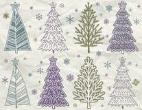 Les arbres de Noël sur le beije chiffonnent le fond Photographie stock