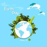 Les arbres de vert de jour de terre se développent du monde de globe Photos stock