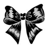 Les arcs avec des rubans noircissent la couleur sur le fond blanc Photographie stock