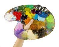 Les artistes remet tenir un pinceau et une palette images libres de droits