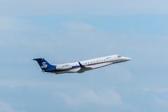 Les avions privés de sino jet décollent Photos stock