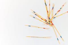 Les bâtons de Mikado ont dispersé sur le fond blanc - 3 photos libres de droits
