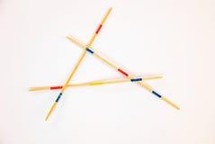 Les bâtons de Mikado ont dispersé sur le fond blanc - 4 photos libres de droits
