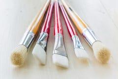 les balais contrôlent des illustrations de construction plus de mon portefeuille de peinture s'il vous plaît Photographie stock libre de droits