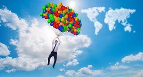 Les ballons de vol d'homme d'affaires le jour lumineux Images stock