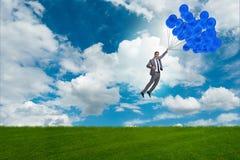 Les ballons de vol d'homme d'affaires le jour lumineux Photo libre de droits