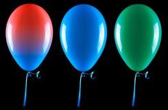 Les ballons de vol ont isolé Photographie stock