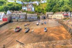 Les bateaux dans Clovelly hébergent Devon England R-U à marée basse dans HDR Images libres de droits