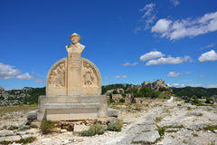 Les Baux, monument of Charloun dou Paradou. LEX BAUX DE PROVENCE, FRANCE - JUL 9, 2014: Monument of Charloun dou Paradou, famous Provencal bard. He is considered Royalty Free Stock Photo