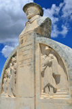 Les Baux, monument of Charloun dou Paradou. LEX BAUX DE PROVENCE, FRANCE - JUL 9, 2014: Monument of Charloun dou Paradou, famous Provencal bard. He is considered Stock Photo