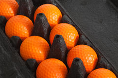 Les billes de golf oranges Photos libres de droits