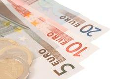 Les billets de banque et les pièces de monnaie de l'euro (d'isolement) Photo libre de droits