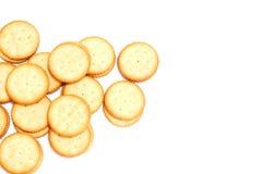 Les biscuits crèmes blancs sur le fond blanc Photographie stock libre de droits