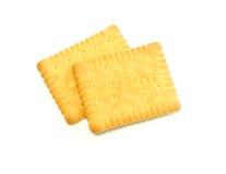 les biscuits de fond ont isolé le blanc Photographie stock libre de droits