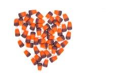 Les bonbons au maïs ont formé dans un coeur Photographie stock