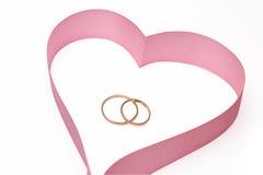 les boucles de coeur enregistrent le mariage sur bande Photographie stock