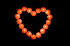 Les bougies ont marqueté le coeur Image stock