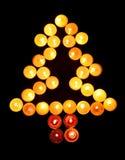 Les bougies ont rayé l'arbre Images libres de droits