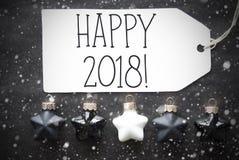 Les boules noires de Noël, flocons de neige, textotent 2018 heureux Photographie stock
