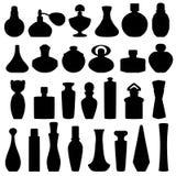 Les bouteilles de silhouettes de parfum sur un fond blanc Tiré par la main image libre de droits