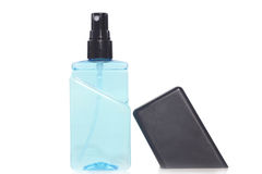 les bouteilles remplies de liquide sont utiles pour des personnes dans le besoin, fond blanc d'isolement Photo stock