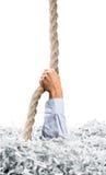 Les bouts droits remettent des papiers déchiquetés par blanc Photographie stock libre de droits