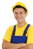 les bras plient heureux ses jeunes d'ouvrier de sourire Images stock