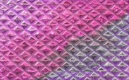 Les briques colorées de mur soustraient le fond avec la texture approximative et brillante Photo libre de droits