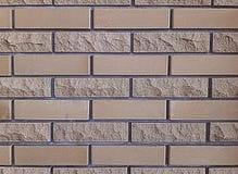 Les briques de finition donnent une consistance rugueuse pour des murs Lisse et ébréché Fond gris extérieur image stock