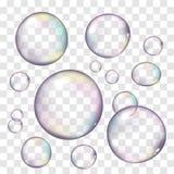Les bulles de savon réalistes ont placé d'isolement sur le fond transparent illustration libre de droits