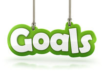Les buts verdissent le texte de mot accrochant sur la corde sur le blanc Photographie stock libre de droits