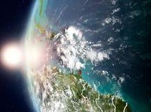 Les Caraïbe pendant le coucher du soleil sur terre Photographie stock libre de droits