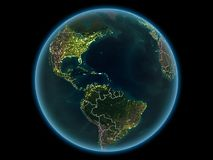 Les Caraïbe sur terre de planète de l'espace la nuit photographie stock libre de droits