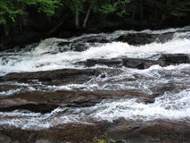 Rapidly flowing waters  Stock Photos