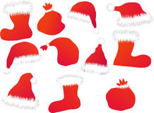 Les chapeaux, les gaines et les sacs de Santa Image stock