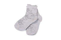 Les chaussettes des enfants d'isolement sur le fond blanc Photographie stock libre de droits