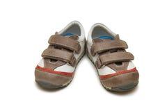 Les chaussures de bébé d'isolement sur le fond blanc Photographie stock