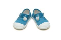 Les chaussures de bébé d'isolement sur le fond blanc Photos stock