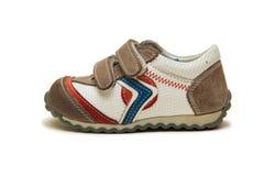 Les chaussures de bébé d'isolement sur le fond blanc Photos libres de droits