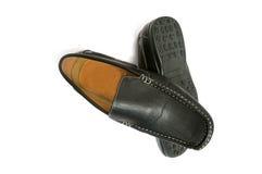Les chaussures de l'homme de couleur d'isolement Images stock
