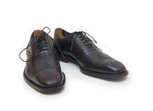 Les chaussures de l'homme de couleur d'isolement sur le fond blanc. Image libre de droits