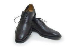 Les chaussures de l'homme de couleur d'isolement sur le fond blanc. Images libres de droits