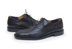 Les chaussures de l'homme de couleur d'isolement sur le fond blanc. Photos libres de droits