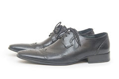Les chaussures de l'homme de couleur d'isolement sur le fond blanc Photos libres de droits