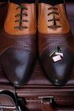 Les chaussures et les boutons de manchette des hommes Photo libre de droits