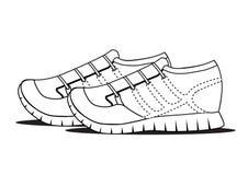 Les chaussures noires d'ensemble sur le fond blanc, sport objecte Image stock