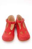 Les chaussures rouges du gosse Images stock