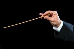 Les chefs d'orchestre remettent avec le bâton. Photos stock
