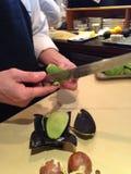 Les chefs de sushi enferment l'avocat Photographie stock libre de droits