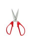 Les ciseaux rouges d'isolement sur un fond blanc sont action de coupe Photos stock